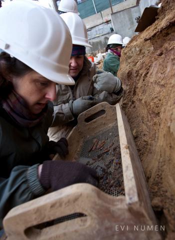 Archaeologists Kimberlee Moran and Anna Dhody Examine Artifacts